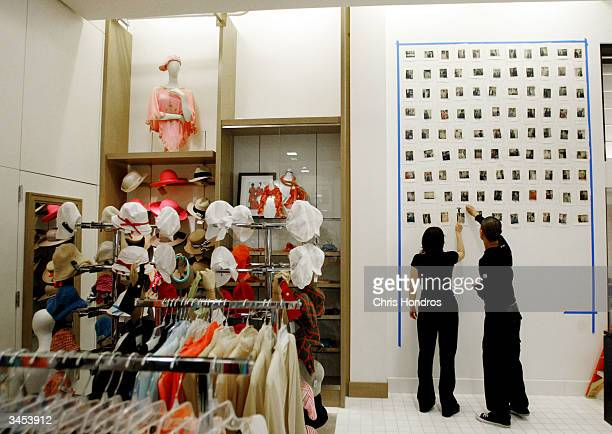 Employees put lastminute touches a wall of staffgenerated artwork at the new Bloomingdale's location in the Soho neighborhood April 21 2004 in New...