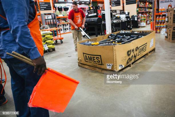 Employees put more shovels out for sale at a Home Depot Inc store ahead of Winter Storm Quinn in Philadelphia Pennsylvania US on Tuesday March 6 2018...