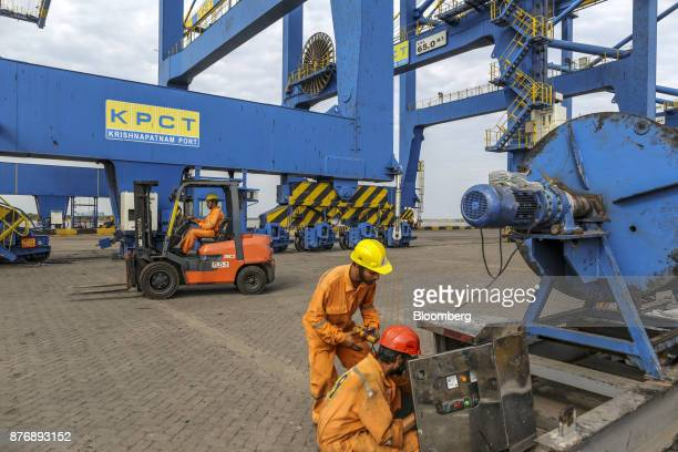 Employees repair a control panel next to a ganty crane at Krishnapatnam Port in Krishnapatnam Andhra Pradesh India on Saturday Aug 12 2017 Growth in...