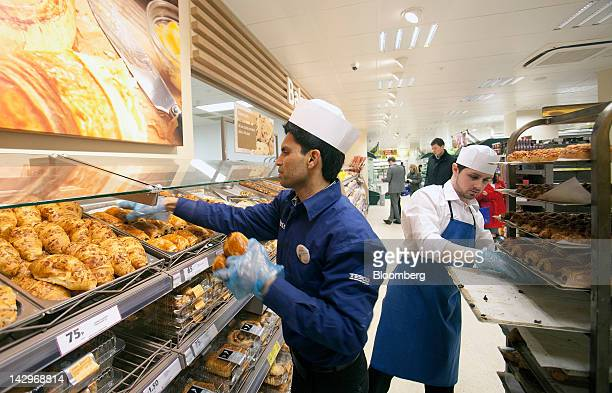 Employees replenishes bread stocks in the bakery at a Tesco Metro store, operated by Tesco Plc, in London, U.K., on Monday, April 16, 2012. Tesco...