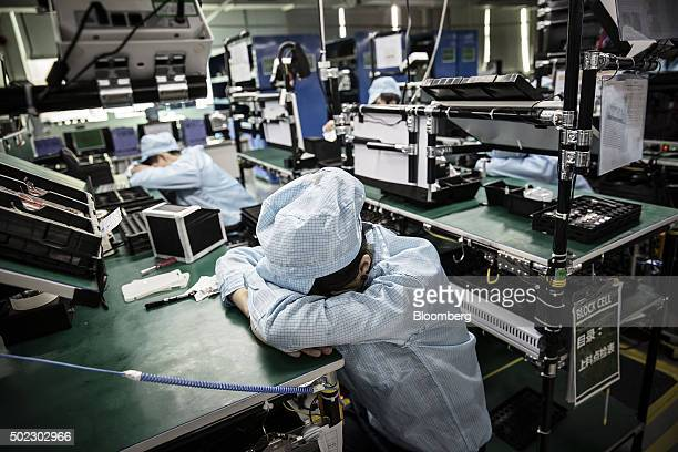 Employees rest during a break at the OnePlus manufacturing facility in Dongguan China on Thursday Dec 17 2015 OnePlus is part of a crop of upstart...