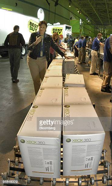 Employees roll out Microsoft Corp.'s new Xbox 360 video-game consoles to be distributed to customers at the Zero Hour event in Palmdale, California....