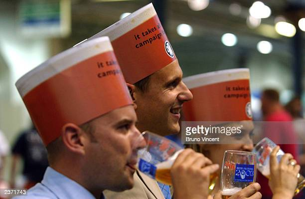 Employees sample some of the beers on offer at the Great British Beer Festival at the Olympia Exhibition Center August 5, 2003 in London, England.