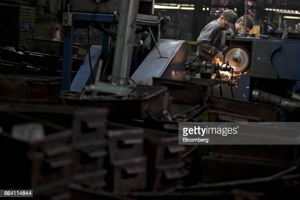 Employees sand forged metal tools at the Vaughan Bushnell Manufacturing Co facility in Bushnell Illinois US on Friday March 31 2017 The US Census...