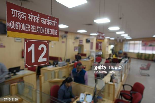 Employees seen inside Punjab National Bank even as the bank is shut for the public at Parliament Street on December 21 2018 in New Delhi India Most...