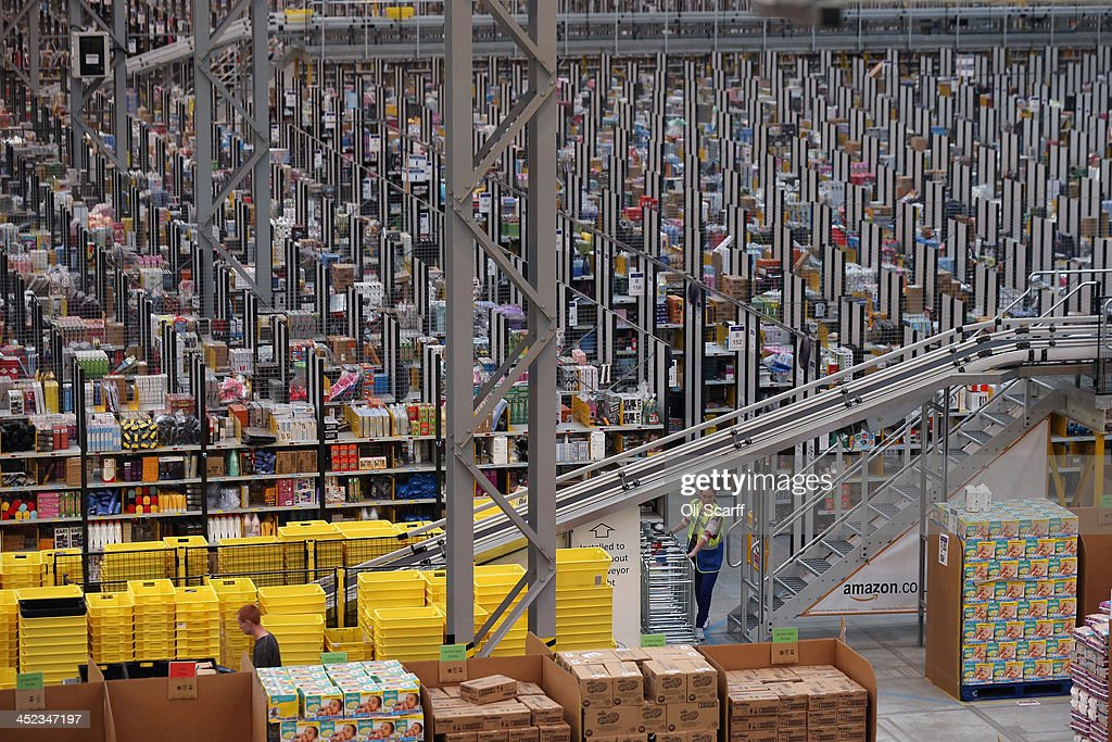 Employees select and dispatch items in the huge Amazon 'fulfilment centre' warehouse on November 28, 2013 in Peterborough, England. The online retailer is preparing for 'Cyber Monday', as it predicts the busiest day for online shopping in the UK will fall on Monday December 2nd this year. On Cyber Monday in 2012 amazon.co.uk recorded over 3.5 million individual items ordered, which equates to 41 items purchased per second. The Peterborough fulfilment centre is 500,000 sq ft, equivalent to approximately seven football pitches in floor area. Amazon are due to employ more than 1,000 seasonal staff to cope with increased demand in the run up to Christmas.