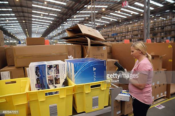 Employees select and dispatch items in the huge Amazon 'fulfilment centre' warehouse on November 28 2013 in Peterborough England The online retailer...