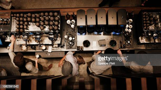 Employees serve customers at a newly opened Starbucks' Reserve Roasteries in the Meatpacking District on on December 14 2018 in New York City The...
