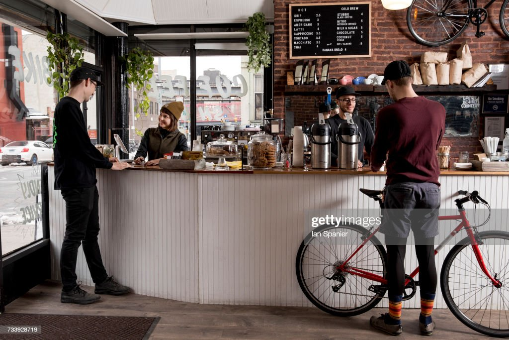 Employees serving customers in cafe, Nike and Coffee shop, New York, USA : ストックフォト