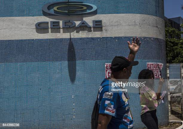 Employees shout slogans during a protest against the privatization of the State's water and sewage utility outside Cia Esadual de Aguas e Esgotos...