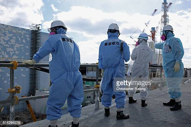 TEPCO employees show a member of the media a destroyed reactor at Fukushima Daiichi nuclear power plant on February 25 2016 in Okuma Japan Five years...
