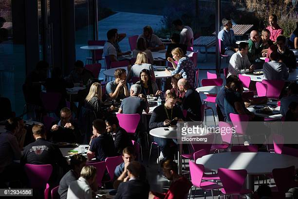Employees sit at tables during lunch in the Lightning cafe at the Dyson Ltd campus in Malmesbury UK on Wednesday Oct 5 2016 In addition to cordless...