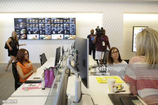 Employees sit at work stations inside the new McDonald's Corp headquarters in Chicago Illinois US on Monday June 4 2018 McDonald's CEO Steve...