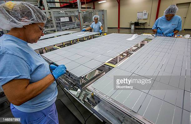 Employees solder strings of solar cells together at the Suntech Power Holdings Co Ltd facility in Goodyear Arizona US on Monday June 18 2012 Suntech...