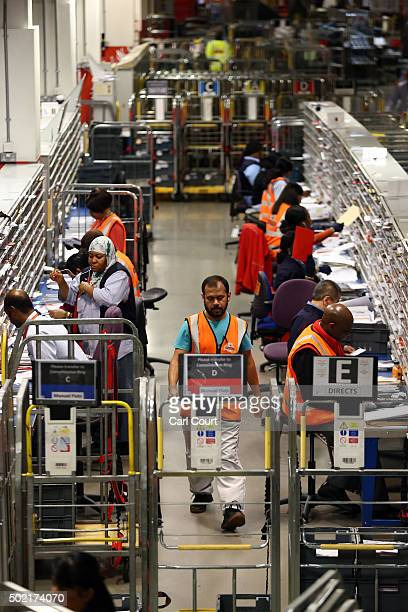 Employees sort deliveries at Royal Mail's Mount Pleasant Mail Centre on December 21 2015 in London England This week is expected to be the busiest of...