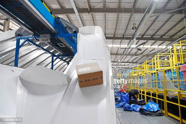 Employees sort out parcels at a logistic base of ZTO Express before the upcoming Double 11 e-commerce festival on November 2, 2020 in Changzhou,...