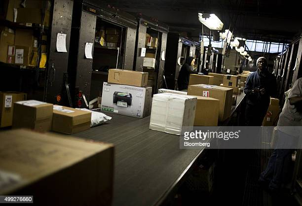 Employees sort packages on Cyber Monday at a United Parcel Service Inc distribution facility in New York US on Monday Nov 30 2015 Online sales on...