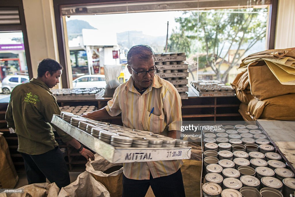 Employees sort tea samples at the Santosh Tea Industries Pvt. office in Coonoor, Tamil Nadu, India, on Saturday, Nov. 30, 2013. India is the worlds largest producer of tea after China. Photographer: Prashanth Vishwanathan/Bloomberg via Getty Images