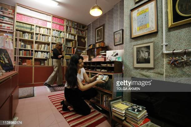 Employees sort the shelves inside The Second Shelf bookshop in central London on March 6 2019 The Second Shelf a bookshop and literary quarterly to...
