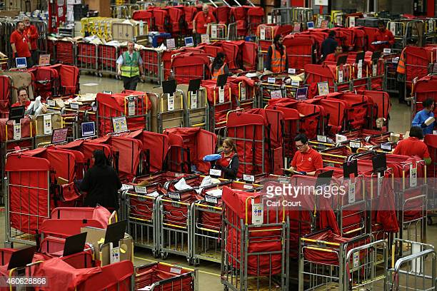 Employees sort through mail on December 17 2014 in Northampton England This week is expected to be the busiest of the year for Royal Mail as they...
