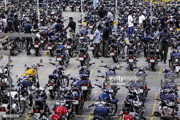 Employees stand among Royal Enfield Motors Ltd. Motorcycles on the production line at the company's manufacturing facility in Chennai, India, on...