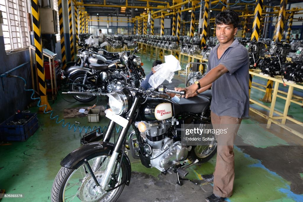 Employees stand among Royal Enfield Motors Ltd motorcycles on the production line at the company`s manufacturing facility in Chennai on January 20...