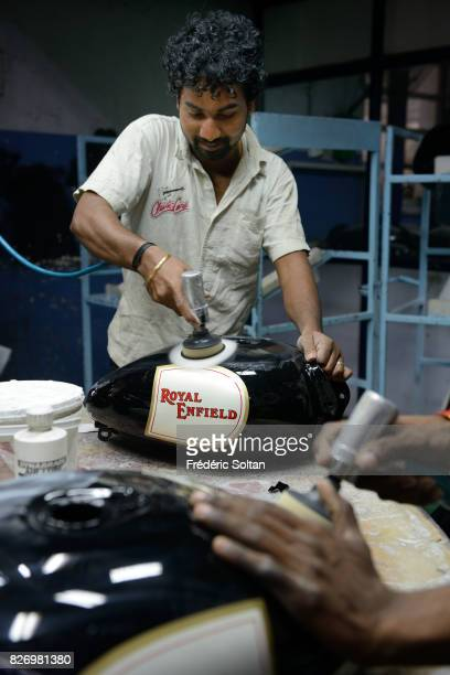 Employees stand among Royal Enfield Motors Ltd motorcycles on the production line at the company's manufacturing facility in Chennai Tamil Nadu on...