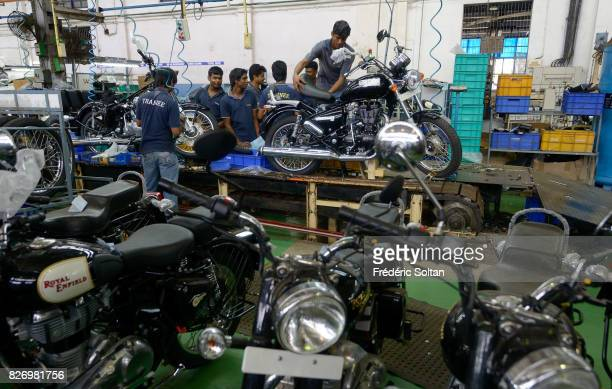 Employees stand among Royal Enfield Motors Ltd. Motorcycles on the production line at the company's manufacturing facility in Chennai, Tamil Nadu on...