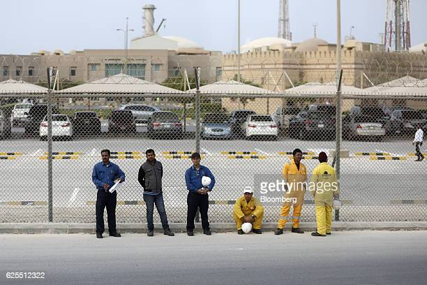 Employees stand and wait for transport from the phosphate processing plant at the Ras Al Khair Industrial City operated by the Saudi Arabian Mining...