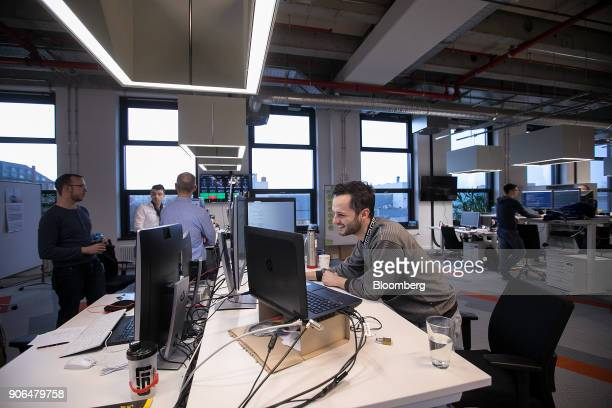Employees stand at desks as Robert Bosch GmbH opens an Internet of Things campus in Berlin Germany on Thursday Jan 18 2018 Germanys largest union...