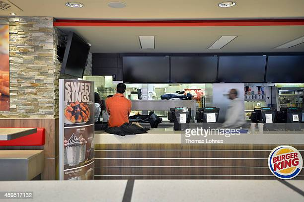Employees stand behind the sales counter of a temorary closed Burger King restaurant on November 24 2014 in Frankfurt Germany It is one of the 89...