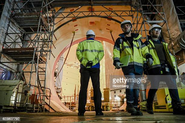 Employees stand inside the reactor building as construction work continues on the Evolutionary Power Reactor nuclear power plant operated by...