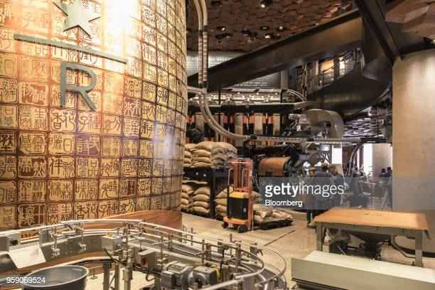 Employees stand near a copper cask left inside the Starbucks Corp Reserve Roastery store in Shanghai China on Friday May 11 2018 Starbucksis laying...