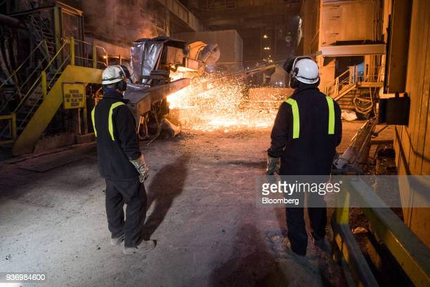 Employees stand next to the electric arc Furnace at Liberty Steel's Aldewerke mill in Rotherham UK on Wednesday March 21 2018 Most metals slumped on...