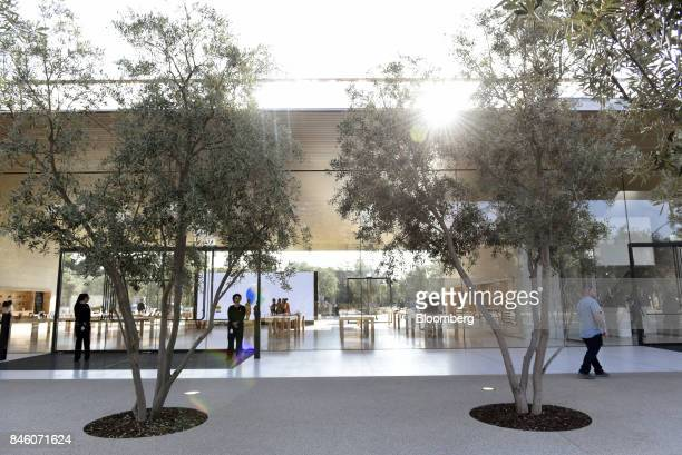 Employees stand outside of an Apple Inc store at the Visitors Center ahead of an event in Cupertino California US on Tuesday Sept 12 2017 Apple plans...