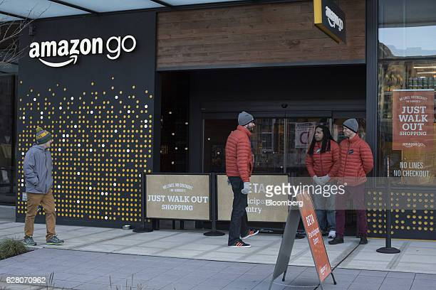 Employees stand outside the new Amazon Go grocery store in Seattle Washington US on Tuesday Dec 6 2016 Amazoncom Inc unveiled technology that will...