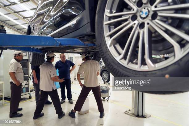 An employee inspects a BMW AG X3 sport utility vehicles on the production line at a PT Gaya Motor plant in Jakarta Indonesia on Wednesday July 18...