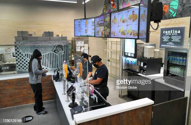 Employees take a customer's order at the new Taco Bell Cantina in Brookline, MA on Dec. 4, 2020. The new Taco Bell on Boston University's campus on...