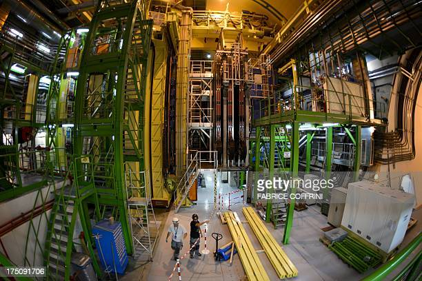 Employees take part in maintenance work at the European Organisation for Nuclear Research Large Hadron Collider on July 19 2013 in Meyrin near Geneva...