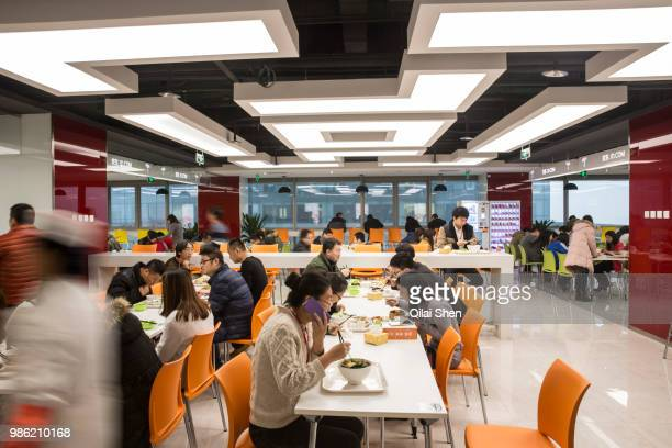 Employees take their lunch in a canteen at JDcom's headquarters in Beijing China on Monday Nov 30 2015 JDcom is China's second largest online...