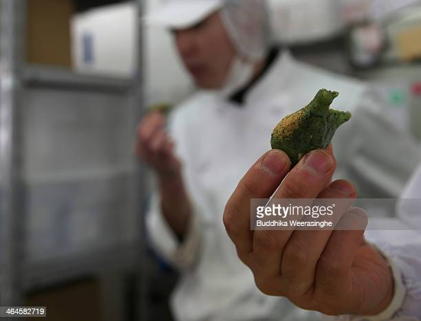 Employees taste freshly made Japanese sweet named Samuchi which are made by Azuki bean and Mochi at Amaneya sweet shop on January 23 2014 in Himeji...
