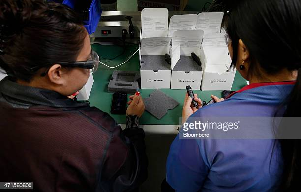 Employees test and package AXON police body cameras at the Taser International Inc manufacturing facility in Scottsdale Arizona US on Wednesday April...