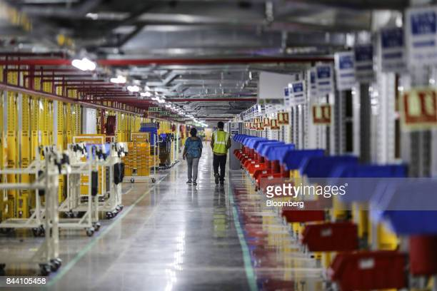 Employees through the Amazoncom Inc fulfillment center in Hyderabad India on Thursday Sept 7 2017 Amazon opened its largest Indian fulfillment center...