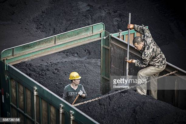 Employees unload coal from a truck at a coal mine and processing facility in Liulin Shanxi province China on Thursday May 19 2016 Shanxi is facing a...