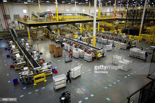 Employees unpack inbound boxes at the Amazoncom Inc fulfillment center on Cyber Monday in Robbinsville New Jersey US on Monday Nov 30 2015 Online...