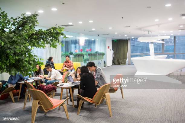Employees use a lounge at JDcom's headquarters in Beijing China on Monday Nov 30 2015 JDcom is China's second largest online retailer and is locked...