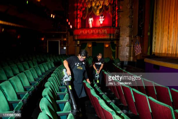 Employees use leaf blowers to help clean inside the El Capitan Theatre, on Hollywood Blvd, in the heart of Hollywood, CA, where Marvel Studios Black...