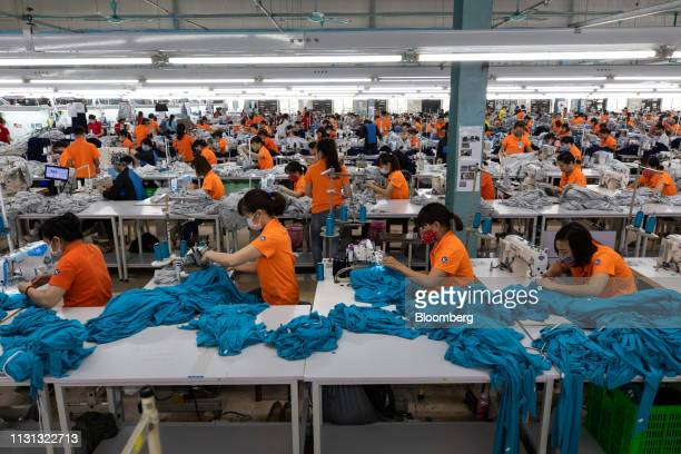 Employees use sewing machines at the PanPacific Co Viet Pacific Clothing factory in Vo Cuong Bac Ninh province Vietnam on Friday March 1 2019 Pan...