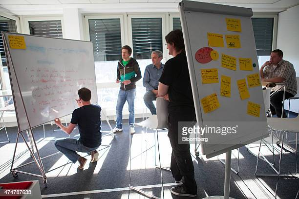 Employees use white boards as they brainstorm in an office inside the SAP AG headquarters in Walldorf Germany on Monday Feb 24 2014 SAP AG coChief...