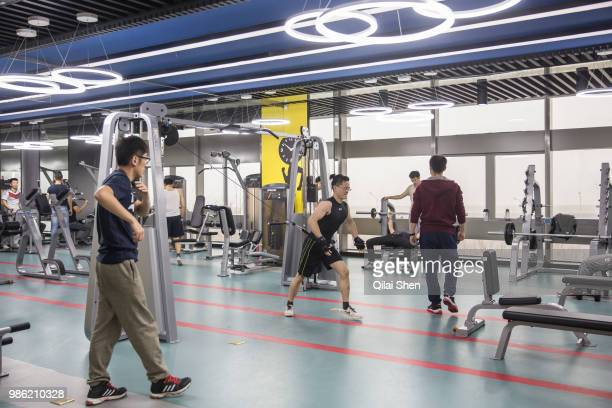 Employees uses the gym during lunch hours at JDcom's headquarters in Beijing China on Monday Nov 30 2015 JDcom is China's second largest online...